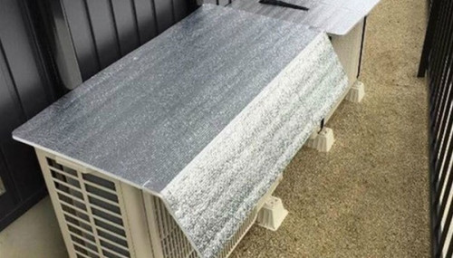 Cover the outdoor unit with an insulating silver sheet